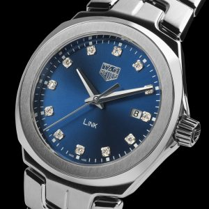 The elegant replica TAG Heuer Link WBC1318.BA0600 watches have blue dials, diamond hour marks and date windows.