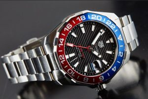 The black dials replica watches have red and blue bezels.