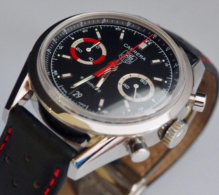The red second hand is striking on the black dial.