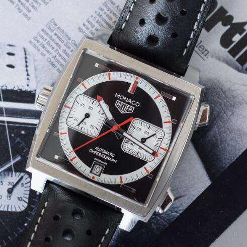 The red and white elements are in contrast to the black dial.