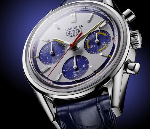 The blue sub-dials and red second hand are striking on the white dial.