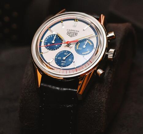 The blue subdials and red second is are contrasted to the silver dial.